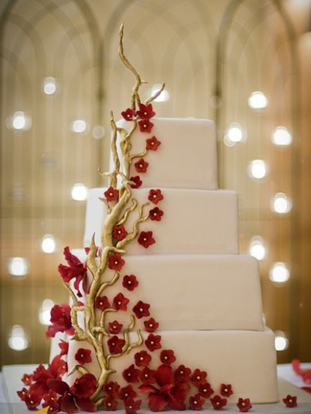 Square Stacked Wedding Cake With Gold Branches Deep Red Blossoms And Orchids