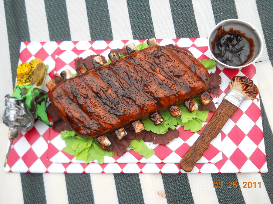 Rack of Ribs, Corn on the Cob Smothered in BBQ Sauce