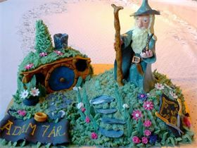 Lord of the rings cake with a hand made Gandalf cake topper