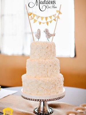 Rosette wedding cake with bunting birds topper!