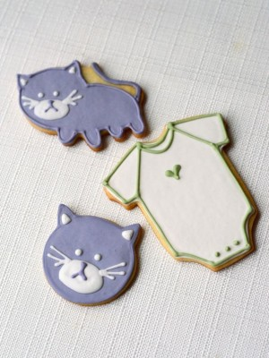 cat cookies and onesie cookies for a baby shower