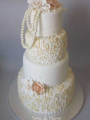 Pearls and orchids wedding cake