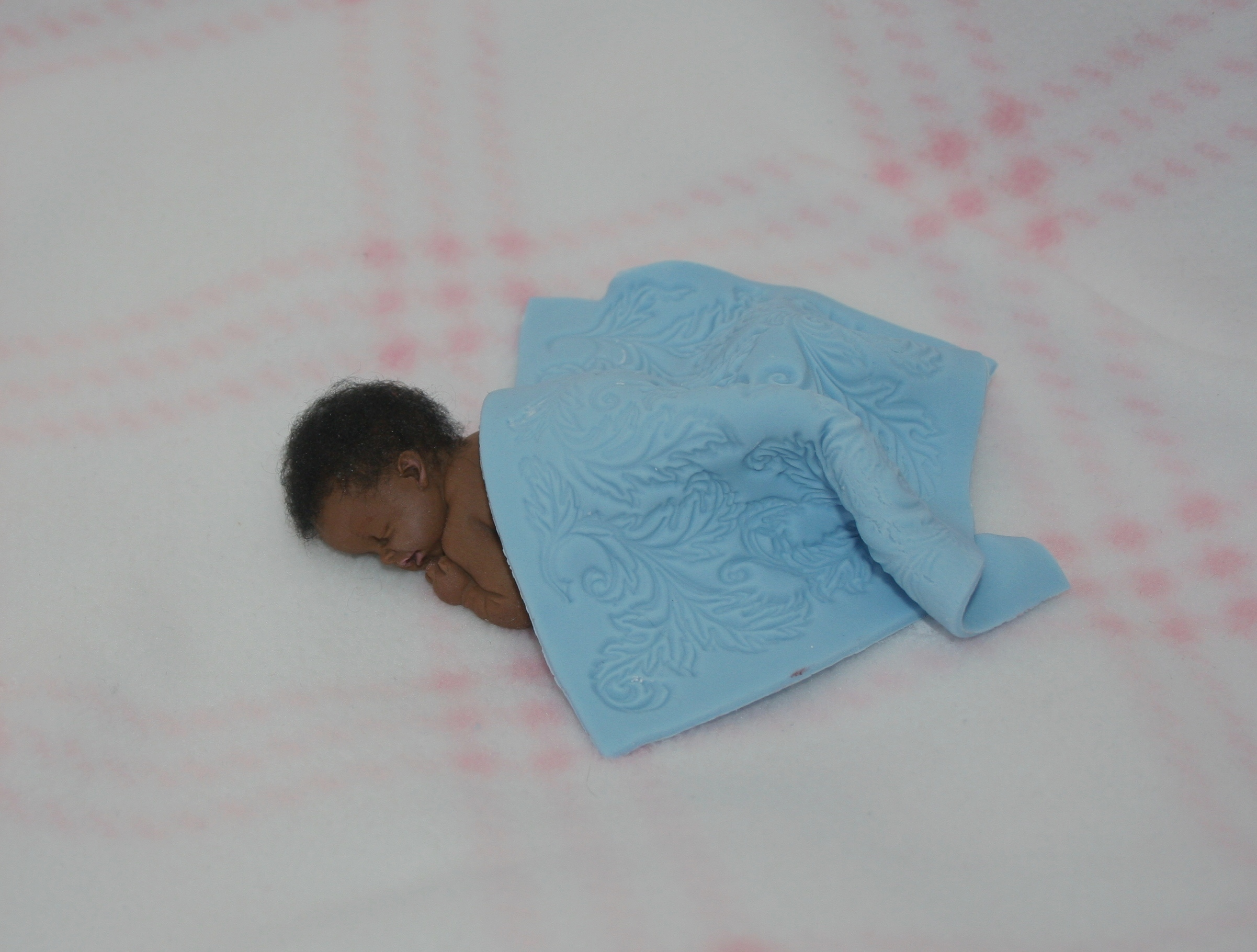 How To Make A Tiny Gumpaste Baby With A Mold Cakecentral Com