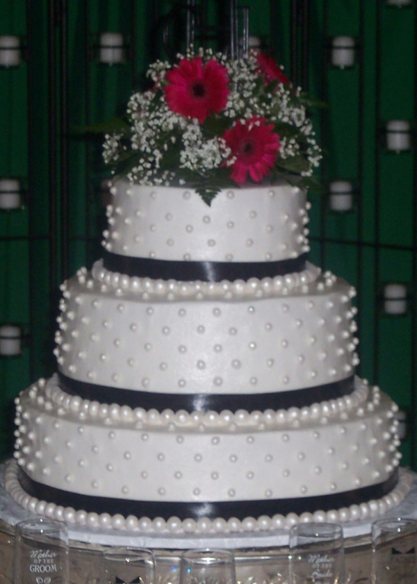 Round Wedding Cake with Pearls Ribbon Flowers and Initials