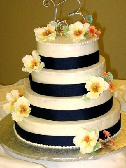 This was a buttercream cake with satin navy blue ribbon gumpaste peonies in