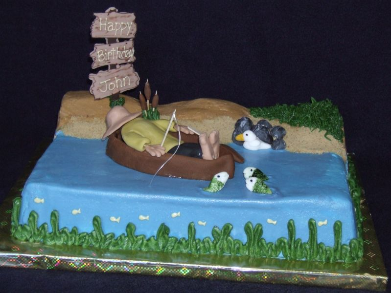 Cake I made for my friend's husband. Was fun to make, man, boat and fish are