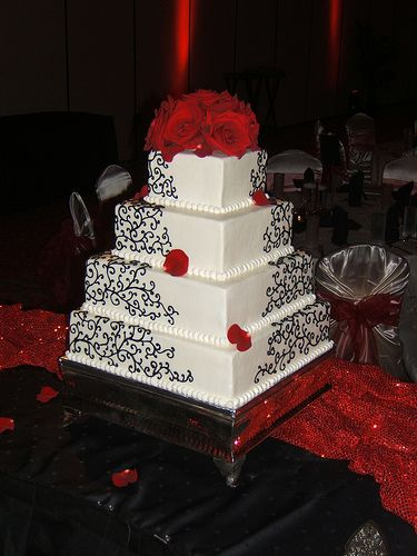 Black Scrolls on White Wedding Cake Uploaded By: arosstx