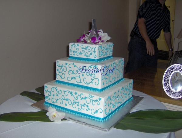 Teal floral scroll wedding cake By FrostinGal 3 tier stacked cake