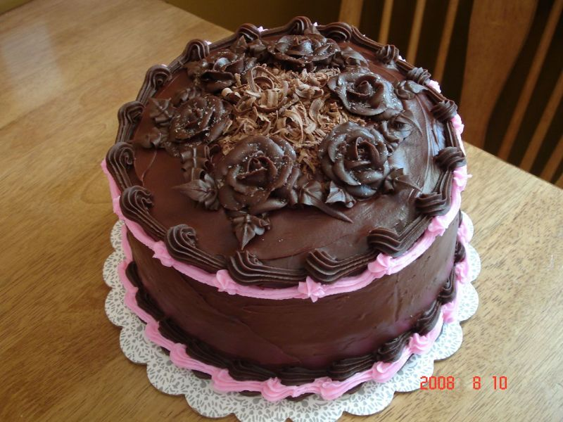 Dark chocolate fudge cake with a chocolate fudge filling topped with even
