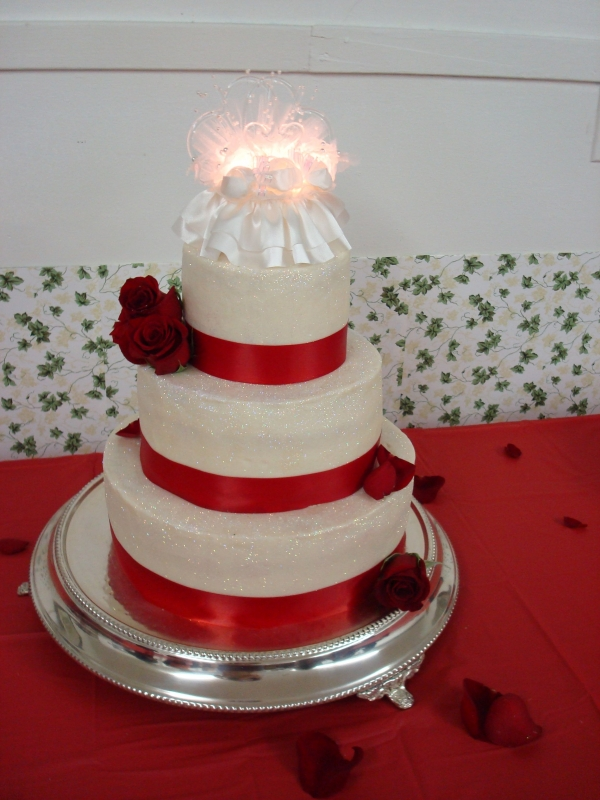 This was their wedding cake anniversary cake I made 6 9 12 inch tiers
