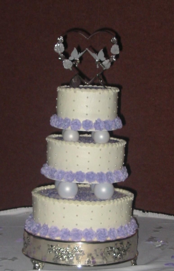 A 6 9 12 wedding cake with buttercream icing and filling and alternating