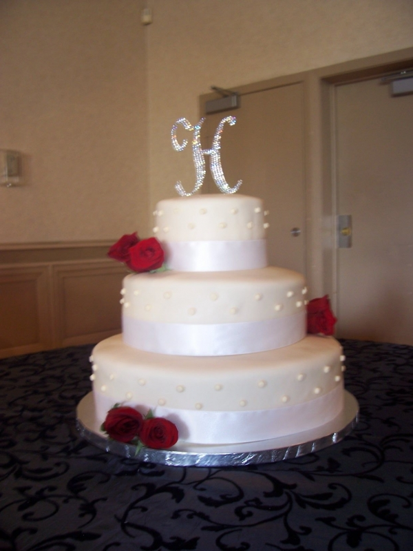 White Buttercream Wedding Cake with Red Roses By steph1130