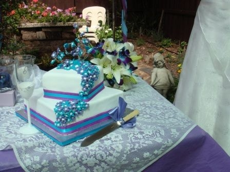 The theme was aqua and purple The top cake is white chocolate mud cake
