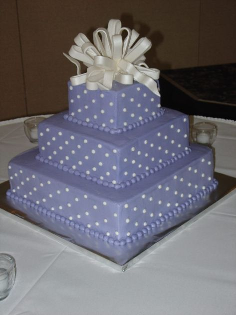 Periwinkle cake with swiss dots and fondant bow
