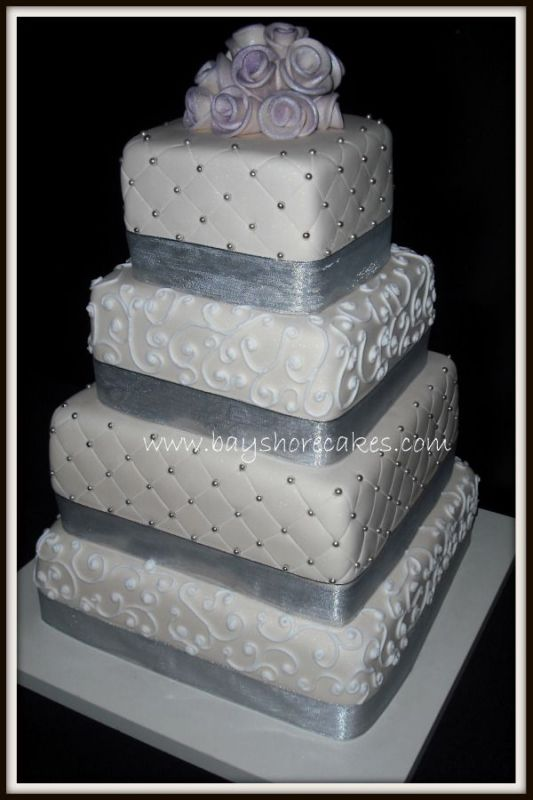 Red white and silver wedding cake with red roses and