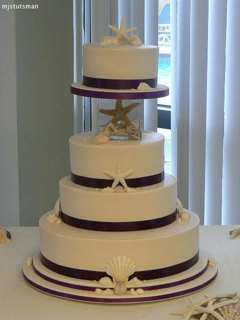 6 8 10 and 14 traditional white wedding cake layers iced with ivory