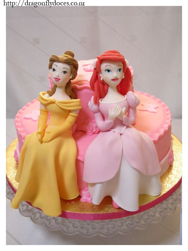 Ariel and Belle Cake Uploaded By: dragonflydoces. A cake featuring Disney's