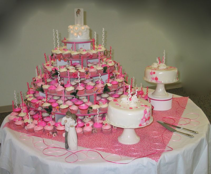 My largest wedding cake yet. 300 cupcakes and 100 servings of strawberry