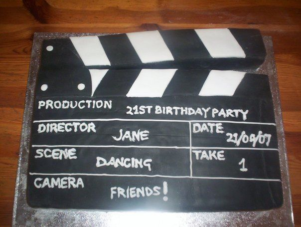 Sheet cake made to look like a clapper board for a movie mad 21st!