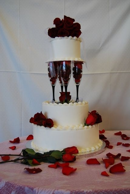 Triple Tier Wedding Cake Supported by Champagne Flutes By laxgal00